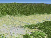 松本市上空より北アルプスを背景に松本盆地を望む(春)