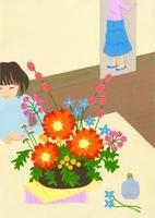 テーブルの上に置かれた花と女の子