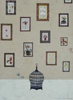 壁一面に飾られたランの絵