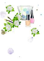 マニキュアとコットンボールとグラスと白い花