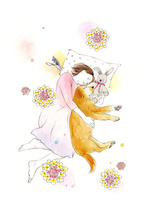 犬と昼寝をする女の子