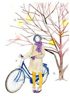 自転車をひく女性