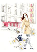 街を歩く女性と白い花