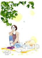 ピクニックをしている女の子と犬