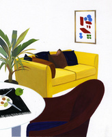 テーブルと黄色いソファのある部屋
