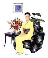 ソファに座る着物を着た女性