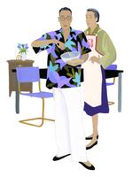 料理をする男性と女性