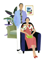 ソファに座る女性と男性