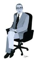 スーツを着てイスに座る男性