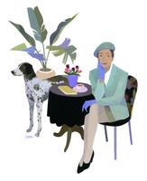 イスに座る女性と犬