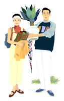 買い物袋を抱える女性と男性