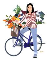 かごに花の入った自転車に乗る女性