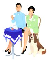 お茶をする女性2人と犬