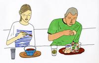 食事をする男性と女性