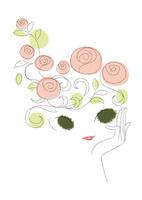 髪に花を飾る女性