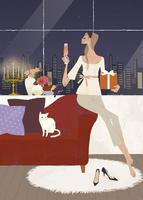クリスマスパーティを猫と一緒に楽しむ女性