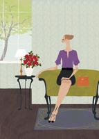 ホテルのロビーのソファで座っている女性