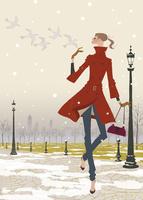 冬の公園で鳥たちと遊ぶ女性