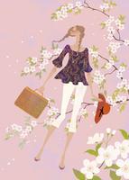 満開の桜の中で散歩をする女性
