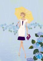 雨の中、紫陽花を楽しむ女性