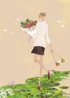 春の緑の中で花束を持つ女性