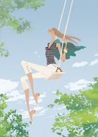 初夏の青空の下でブランコを楽しむ女性