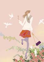 春の花の中で鳥と戯れる女性