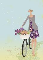 カゴに花束を乗せた自転車を押す女性