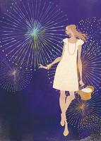 花火を楽しむワンピース姿の女性