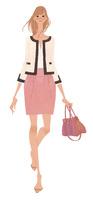 OL風のファッションに身を包み歩く女性