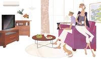 リビングのソファに座り犬と一緒にくつろぐ女性と男性
