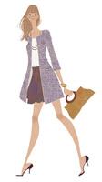 春コートを着て嬉しそうに歩く女性