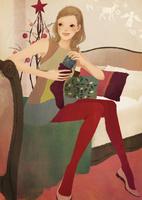 ベッドに座りクリスマスプレゼントを用意する女性 02675000019| 写真素材・ストックフォト・画像・イラスト素材|アマナイメージズ