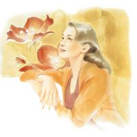 赤い花上を向く女性