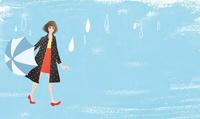 雨の日に女性が散歩