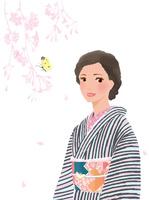 しだれ桜とモンキチョウと着物姿の女性