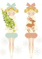 クリスマスツリーとトナカイを持った女の子