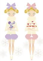 オーナメントとカップケーキを持ったの女の子