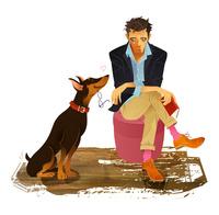 犬と読書する男性