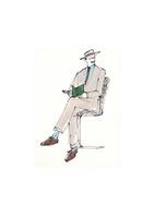 イスに座ってメモをとるスーツ姿の男性