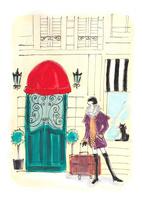 冬のパリの街角に立つ旅行中の女性