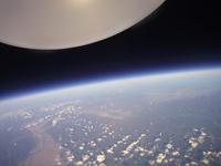 宇宙と地球の境界 高高度札幌上空から北海道東部を撮影 02740000095| 写真素材・ストックフォト・画像・イラスト素材|アマナイメージズ