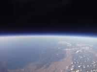 宇宙と地球の境界 高高度札幌上空から北海道東部を撮影 02740000098| 写真素材・ストックフォト・画像・イラスト素材|アマナイメージズ