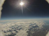 札幌上空 対流圏界面から撮影した雲海と太陽