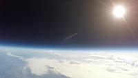 宇宙から見た夕暮れ 西日に照らされ輝く雲 スペースバルーン 02740000285| 写真素材・ストックフォト・画像・イラスト素材|アマナイメージズ