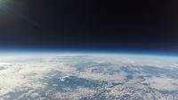 宇宙から見た夕暮れ 西日に照らされ輝く雲 スペースバルーン