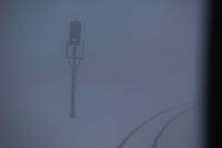 車窓 吹雪の米坂線
