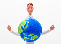 地球に手をかざすスーツの男性