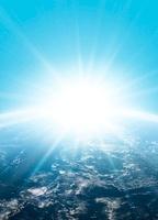光と地球のイメージ