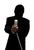 受話器を持っている男性のシルエット